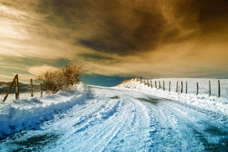 winter scene: road with cool sunset and snow