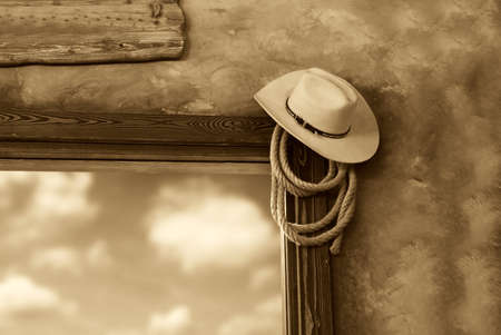 cowboy's: cowboy hat and rope in the saloon