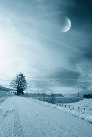 polar landscape with snow and moon light photo