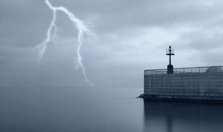 lightning on the ocean near the pier photo
