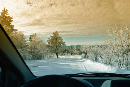 snowy road at sunset in mountain photo