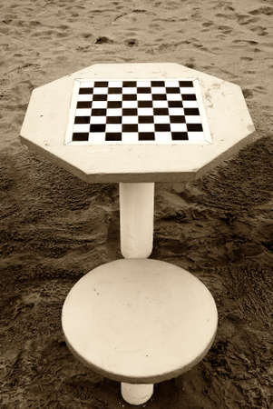 chees: old table chees on the sand in the beach Stock Photo