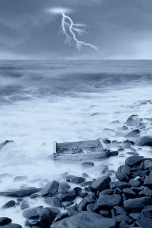 wooden box brought ashore by the storm Stock Photo - 10431756