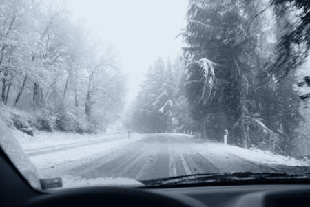 road conditions: dangerous road with snow and ice Stock Photo