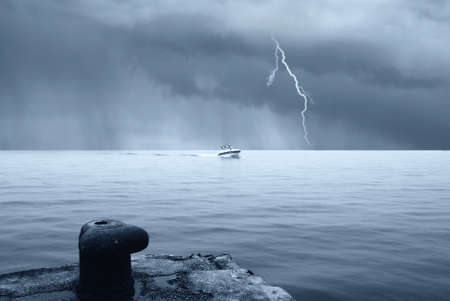 motorboat in the sea with stormy sky with lightning Stock Photo - 10516934