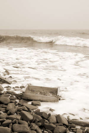 old wooden box on the shore after the storm Stock Photo - 10946440