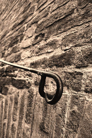 rurale: handrails on the old brick wall