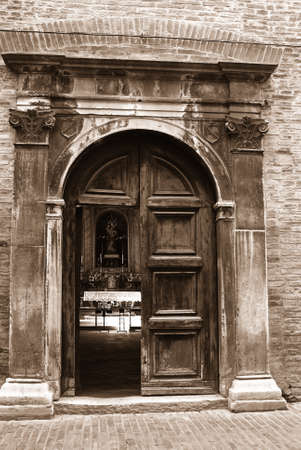 old church with a wooden door opened photo