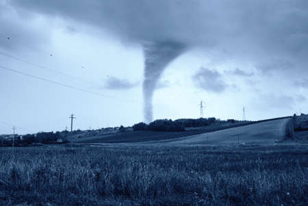incredible twister behind the hill photo
