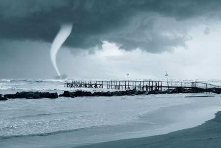 twister near the pier in summer photo