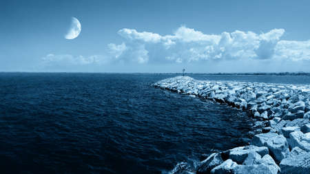moon on the ocean in evening photo