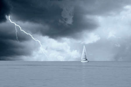 sailing boat under stormy sky photo