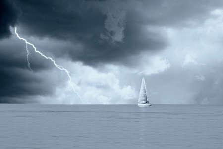 sailing boat: sailing boat under stormy sky