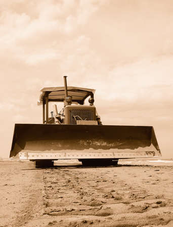 old caterpiller on the sand photo