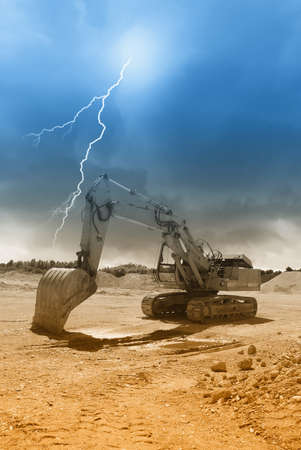 old excavator in the quarry under amazing sky photo