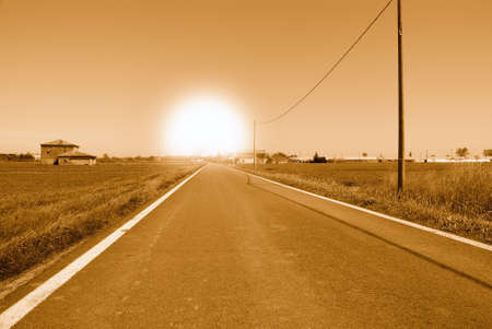 sun at horizon at the end of the road Stock Photo - 14318655