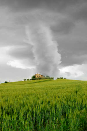tornado surrounds the house on the hill Stock Photo - 14318640