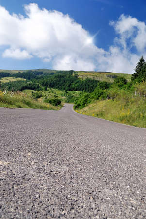 road in mountain with cloudy sky Stock Photo - 14568527