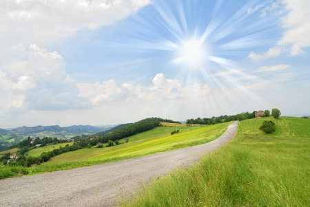 sun over countryroad in summer Stock Photo - 14568503