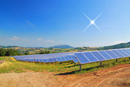 solar panels in countryside under blu sky photo