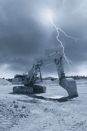old excavator in the quarry under cludy sky Stock Photo - 14849058