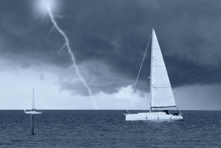 sailing boats in the sea under cloudy sky photo