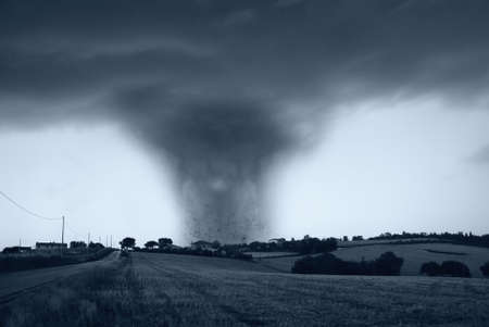 amazing tornado with dark sky at horizon Stock Photo - 15716289