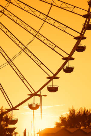 ferris wheel with amazing orange sky at sunset photo