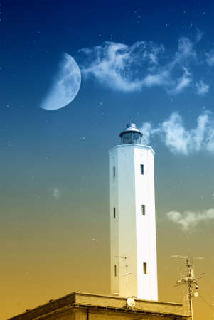 lighthouse in the night with moon in the sky photo