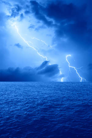 lightning on the sea in the night photo