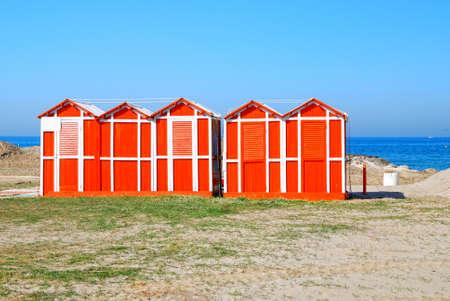 rimini: wooden cabins on the sand in rimini, italy