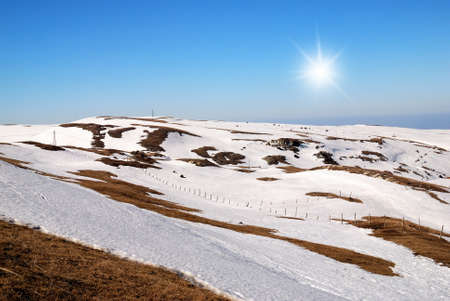 plateau in winter with snow and sun in the sky photo