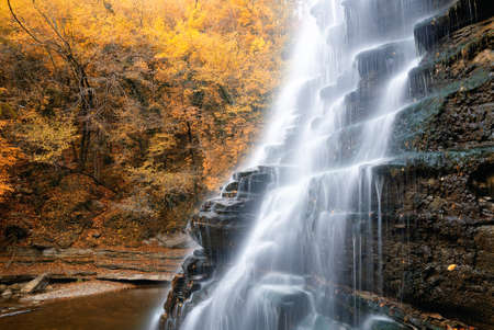 cool natural cascade in the park in october photo