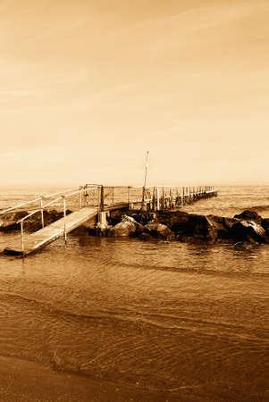 old bridge over the sea in autumn photo