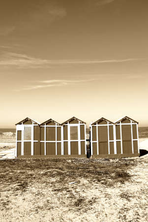 old wooden cabins on the beach photo