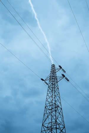 over voltage: lightning over high voltage pylon in the evening Stock Photo