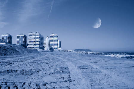 beach in the evening with moon in the sky photo