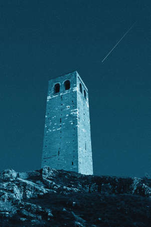 old tower under starry sky photo