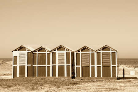 old wooden cabin on the sand near the sea in rimini, italy photo