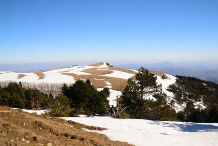 hill with snow in winter photo