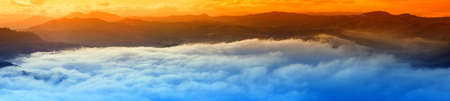 amazing sunset over the clouds in mountain photo