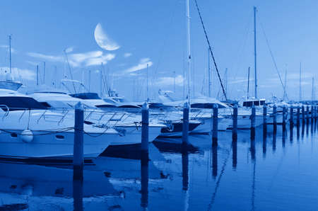 boats in the port at moonlight photo