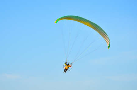 paraglide: paraglider in flight in blue sky