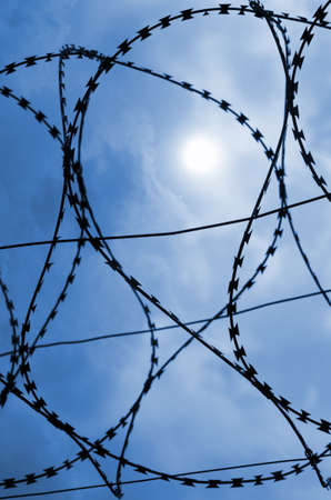 isolated barbed wire with cloudy sky photo