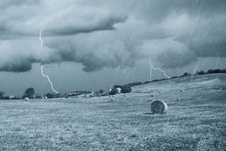 wind storm: storm with lightning in countryside in august