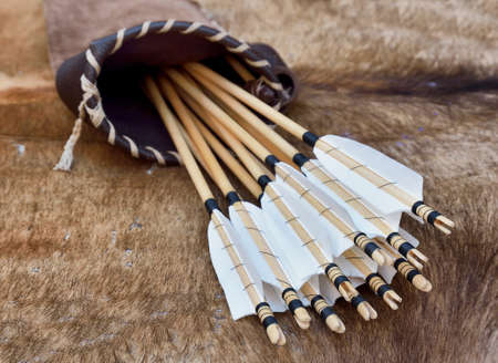 quiver: ancient quiver with arrows over the table