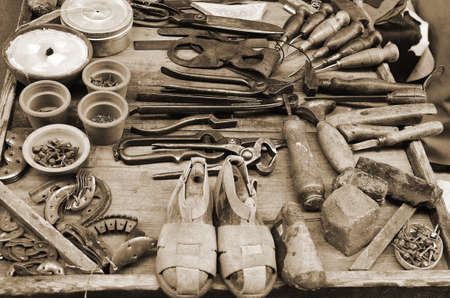 repairer: old tools shoemaker over the table of  the shop Stock Photo