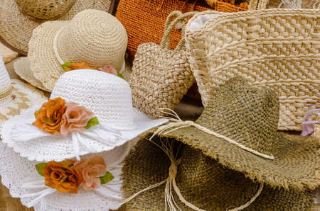 boater: many hats made by hand over the table at the market