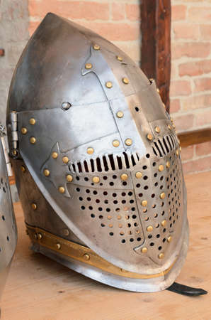 armoring: Ancient helmet over the table in the museum