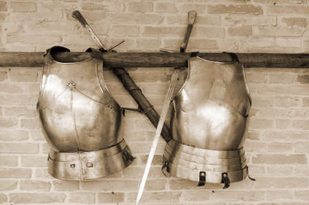 armoring: Couple of armors hanging the wall